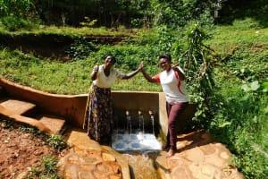 The Water Project: Shirakala Community, Ambani Spring -  Rhoda Sakwa And Field Officer Jacklyne