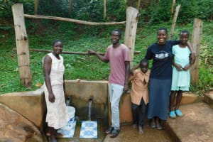 The Water Project: Irumbi Community, Okang'a Spring -  Victor Musoga Center With Bravin And Field Officer Rose To This Right