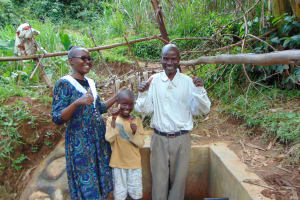 The Water Project: Musiachi Community, Thomas Spring -  Field Officer Joan Were With Austine And Juma