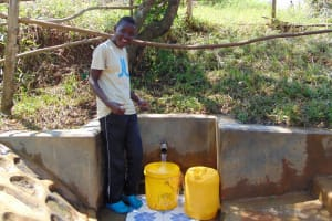 The Water Project: Mungaha B Community, Maria Spring -  Violet Khanal Shows His Enthusiasm For The Spring