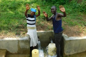 The Water Project: Chegulo Community, Yeni Spring -  Susan Makhokha And Community Member