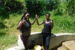 The Water Project: Chegulo Community, Werabunuka Spring -  Field Officer Jacklyne Chelagat With Margret