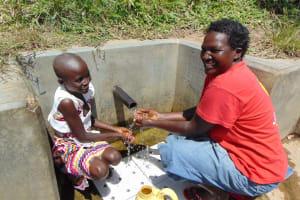 The Water Project: Shirugu Community, Shapaya Mavonga Spring -  Celestine And Violet Enjoying The Spring Water