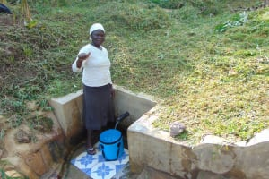 The Water Project: Ematetie Community, Weku Spring -  Doris Shitsuli Gives A Thumbs Up For Clean Water