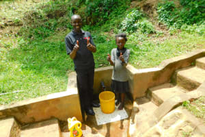 The Water Project: Samisbei Community, Isaac Rutoh Spring -  Faith Lukhanji With Field Officer Wilson Kipchoge
