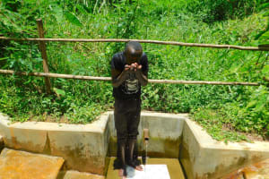 The Water Project: Koitabut Community, Henry Kichwen Spring -  Ivan Kibungei Lugaye Takes A Drink From The Spring