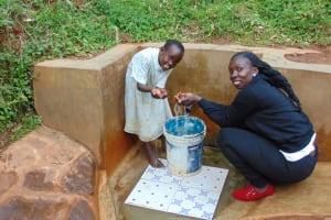 The Water Project: Chepnonochi Community, Chepnonochi Spring -  Field Officer Laura Alulu With Sarah