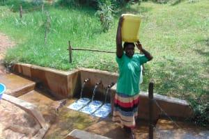 The Water Project: Irumbi Community, Shatsala Spring -  Joyce Vihenda Ready To Carry Water Home