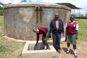 The Water Project: Kaimosi Demonstration Secondary School -  Yvonne Igamihi Principal Amalemba And Cynthia Anzemo At The Rain Tank