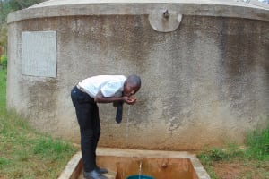 The Water Project: Lwanda Secondary School -  Renson Takes A Drink From The Rain Tank