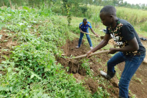 The Water Project: Ikonyero Community, Amkongo Spring -  Digging Cut Off Drainage