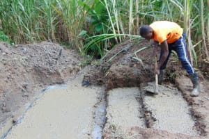 The Water Project: Buyangu Community, Osundwa Spring -  Laying The Spring Foundation