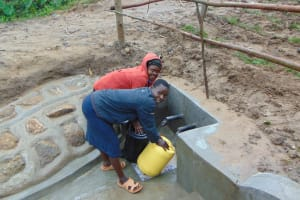 The Water Project: Sasala Community, Kasit Spring -  Happy Fetching Water