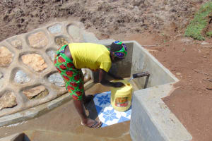 The Water Project: Shihungu Community, Shihungu Spring -  Fetching Clean Water