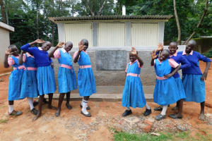 The Water Project: Kimangeti Primary School -  Girls Pose With Their New Latrines