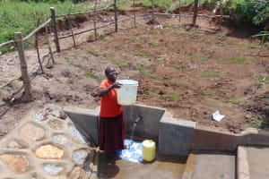 The Water Project: Shihungu Community, Shihungu Spring -  Mounting Clean Water To Go Home