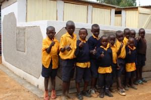 The Water Project: Friends Primary School Givogi -  Boys In Fron Of Latrines