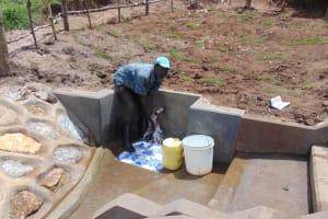 The Water Project: Shihungu Community, Shihungu Spring -  Enjoying The Spring Water