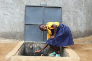 The Water Project: Friends Primary School Givogi -  Enjoying The Rain Tank Water