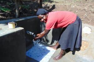 The Water Project: Buyangu Community, Osundwa Spring -  Enjoying The Spring Water