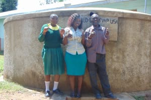 The Water Project: Madegwa Primary School -  Charity Field Officer Laura Alulu Mr Lukao