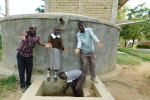The Water Project: Lusiola Primary School -  Field Officer Victor Musemi With Students And Mr Chisikwa At Rain Tank