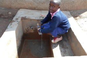 The Water Project: Friends Kaimosi Demonstration Primary School -  Student Gets A Drink
