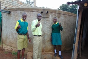 The Water Project: Gemeni Salvation Primary School -  Mr Wegulo With Arnold And Faith