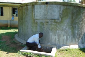 The Water Project: St. John Cheptech Secondary School -  Mr Idache At The Rain Tanks Tap