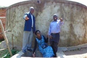 The Water Project: Muyere Primary School -  Field Officer Joan Were With Mr Namasake And Another School Administrator