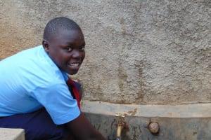 The Water Project: Gidagadi Secondary School -  Student At The Rain Tanks Tap