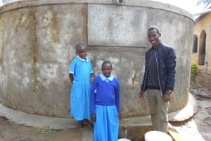 The Water Project: Shivanga Primary School -  Field Officer Ian Nakitare With Beatrice And Anne