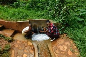 The Water Project: Shirakala Community, Ambani Spring -  Field Officer Jaclyne With John Lihavo