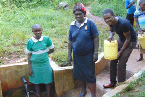 The Water Project: Musutsu Community, Mwashi Spring -  Nelly Her Mother Beatrice Musimbi And Field Officer Samuel