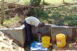The Water Project: Mungaha B Community, Maria Spring -  Khanal Enjoying The Spring Water