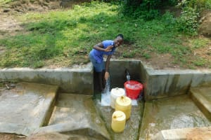 The Water Project: Chegulo Community, Yeni Spring -  Mary Japheth At The Spring