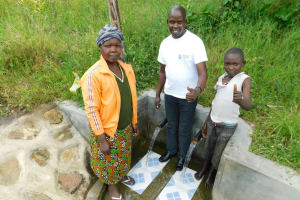 The Water Project: Muyundi Community, Ngalame Spring -  Alice Field Officer Jonathan And Edwin