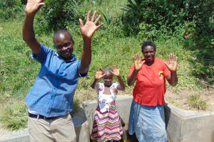 The Water Project: Shirugu Community, Shapaya Mavonga Spring -  Field Officer Victor Musemi With Celestine And Violet