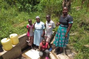 The Water Project: Emasera Community, Visenda Spring -  Field Officer Betty With Spring Users