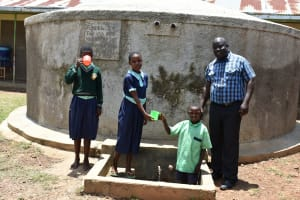 The Water Project: Mukunyuku RC Primary School -  Students And Mr Wesonga At The Rain Tank