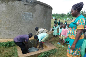 The Water Project: Eshikufu Primary School -  Sanitation Patron Supervises Water Collection For Kitchen Use