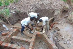 The Water Project: Shihungu Community, Shihungu Spring -  Wall Construction