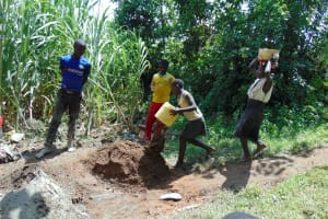 The Water Project: Buyangu Community, Osundwa Spring -  Community Members Help Deliver Materials
