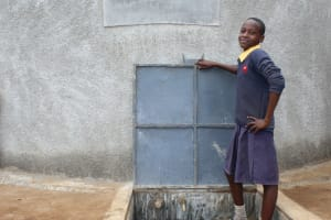 The Water Project: Friends Primary School Givogi -  Standing Proud With The Rain Tank