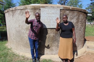The Water Project: Mavusi Primary School -  Victor And Mrs Nkumu At The Rain Tank
