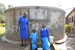 The Water Project: Shivanga Primary School -  Madam Miriam Memeti With Beatrice And Anne