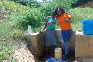 The Water Project: Musango Community, Jared Lukoko Spring -  Field Officer Georgina With Community Member