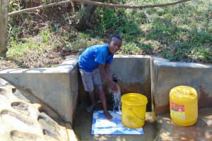 The Water Project: Mungaha B Community, Maria Spring -  Child At The Spring