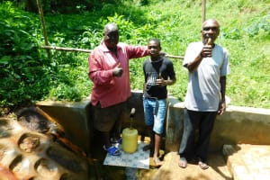 The Water Project: Koloch Community, Solomon Pendi Spring -  Thumbs Up For Clean Water Tom Musa In Center