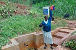 The Water Project: Chepnonochi Community, Chepnonochi Spring -  Christine Ready To Take Her Water Home